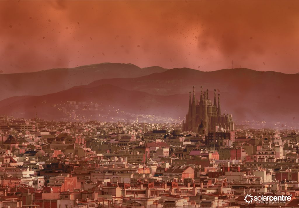 Barcelona city with red sky from wildfire